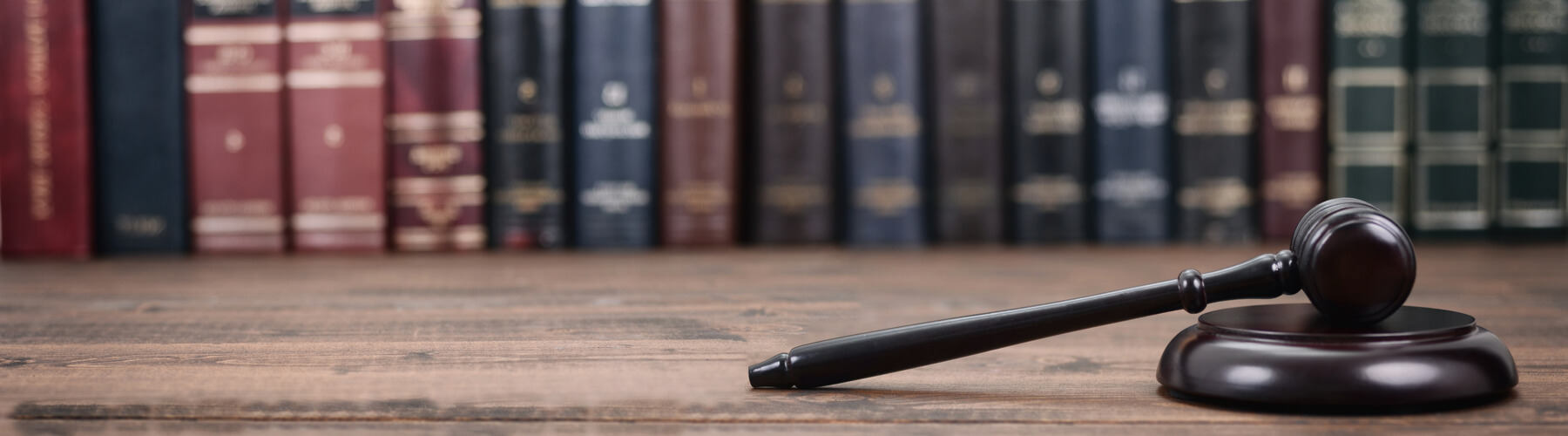 Law and Justice, Legality concept, Judge Gavel on a wooden background, Law library concept.