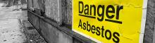danger, asbestos sign on concrete wall